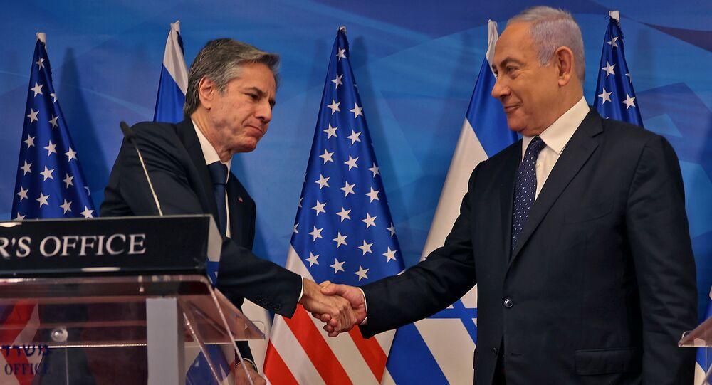 İsrail ile Hamas arasındaki 21 Mayıs ateşkesi sonrası Kudüs'e giden ABD Dışişleri Bakanı Antony Blinken, İsrail Başbakanı Benyamin Netanyahu ile ortak basın toplantısında el sıkışırken