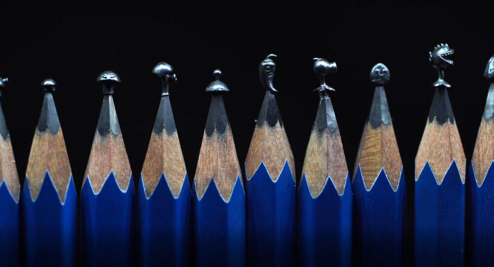 Çinli sanatçı yaptığı mikro heykelciklerle kalem uçlarına yaşam katıyor