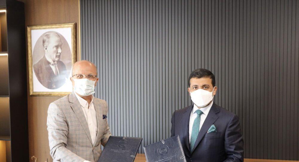 Prof. Dr. Erol Özvar ve Dr. Hassan Al-Derham