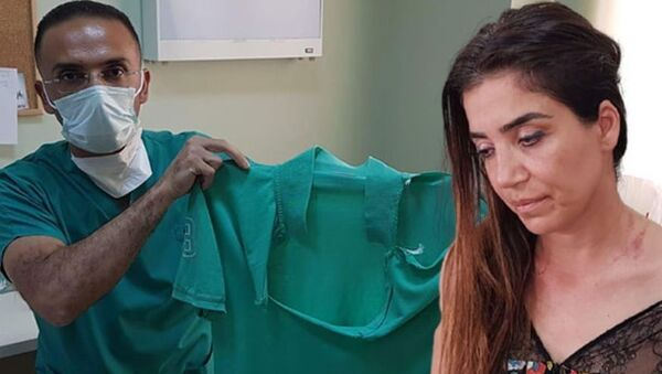 İskenderun Devlet Hastanesi'nde görevli doktorlar Emrah Kara ile Nalan Alev Alp - Sputnik Türkiye