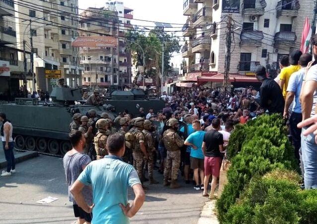 Lübnan'da Saad Hariri'nin hükümeti kurmayacağını açıklamasının ardından başlayan gösteriler devam ederken, Trablusşam kentinde çıkan çatışmada 25 kişi yaralandı.