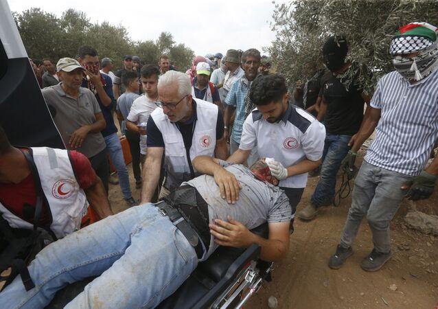 Filistin Kızılayı, İsrail güçlerinin Batı Şeria'nın Beita kasabasında yasa dışı Yahudi yerleşim politikalarına karşı gerçekleştirilen protestoya müdahalesinde 320 Filistinlinin yaralandığını duyurdu.