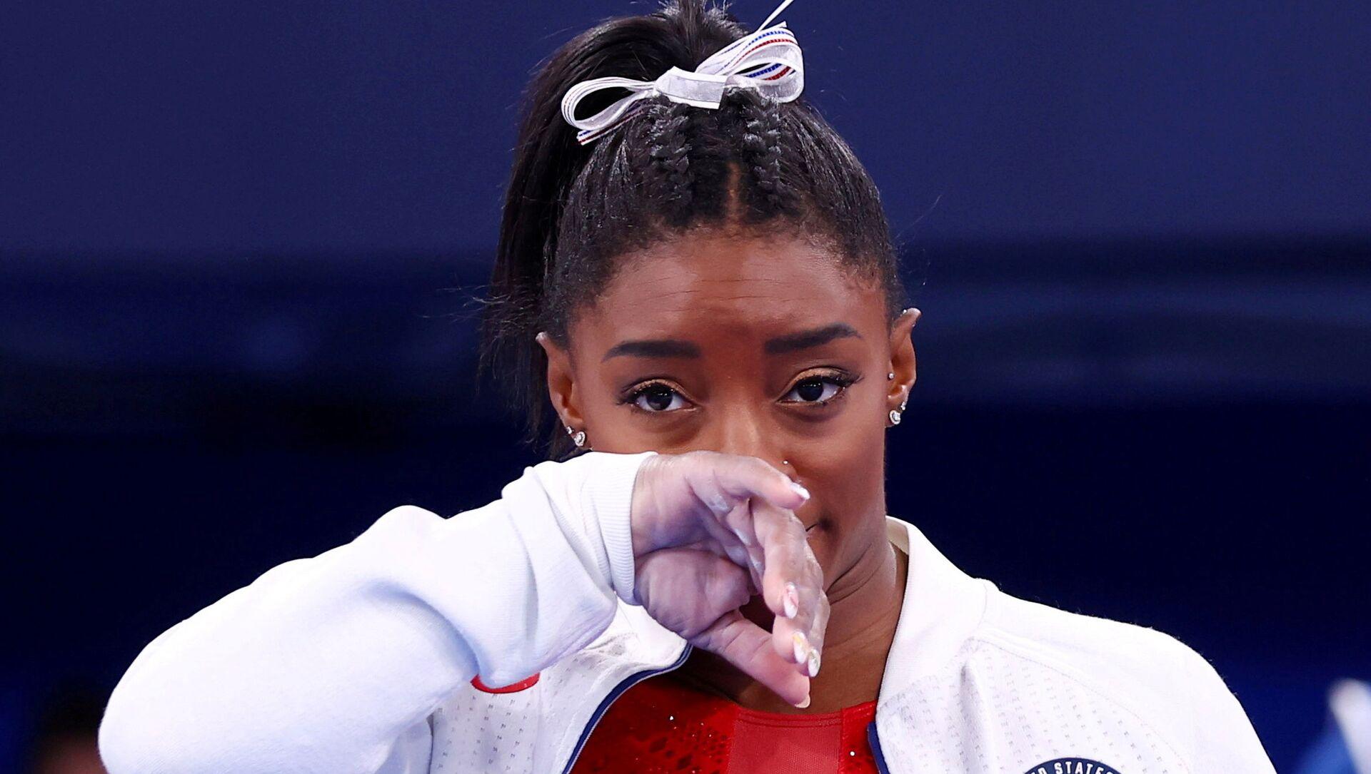 Tokyo Olimpiyatı'nda zorlanan ve üst üste finallerden çekilen ABD'li jimnastikçi Simone Biles - Sputnik Türkiye, 1920, 28.07.2021