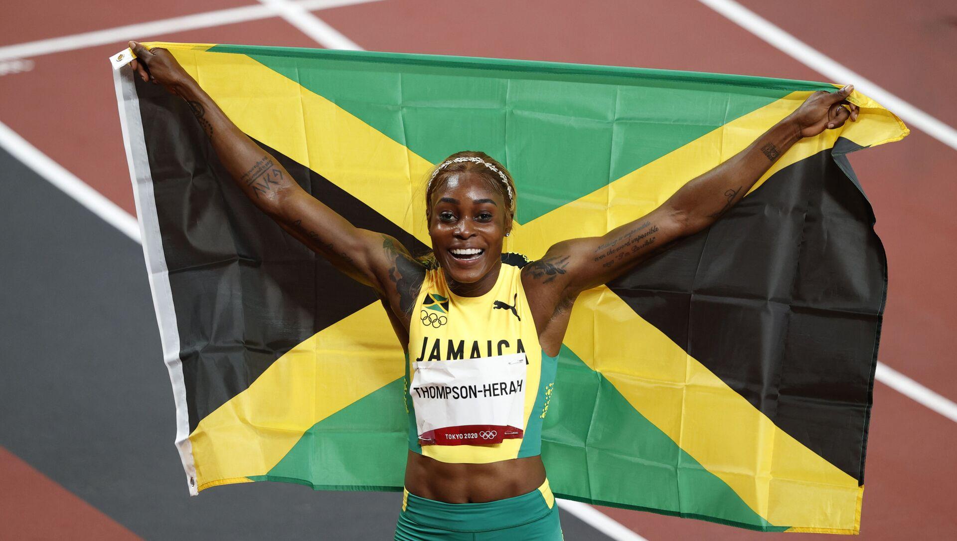 2020 Tokyo Olimpiyat Oyunları'nın sekizinci gününde atletizmde kadınlar 100 metre finalinde Jamaikalı Elaine Thompson, olimpiyat rekoru kırarak altın madalyayı elde etti. - Sputnik Türkiye, 1920, 01.08.2021