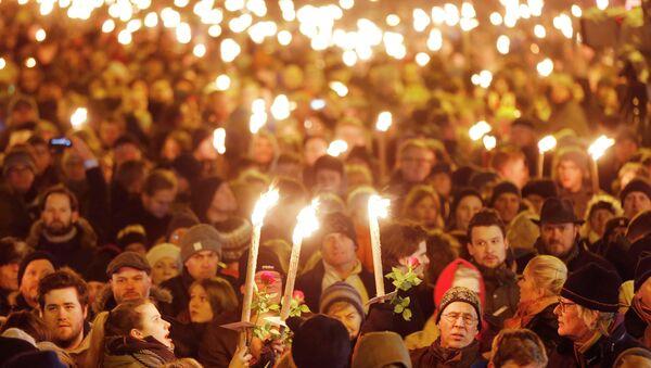 Danimarka'nın başkenti Kopenhag'da düzenlenen saldırılarda hayatını kaybeden 2 kişi anıldı. - Sputnik Türkiye