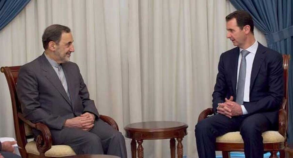 İran'ın dini lideri Ayetullah Ali Hamaney'in Başdanışmanı Ali Ekber Velayeti ve Suriye Devlet Başkanı Beşar Esad