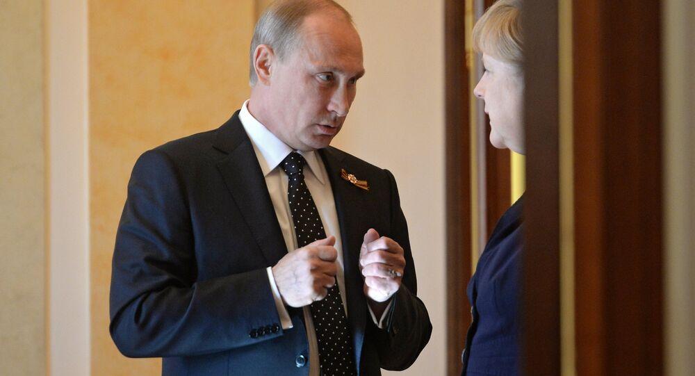 Rusya Devlet Başkanı Vladimir Putin ve Almanya Başbakanı Angela Merkel