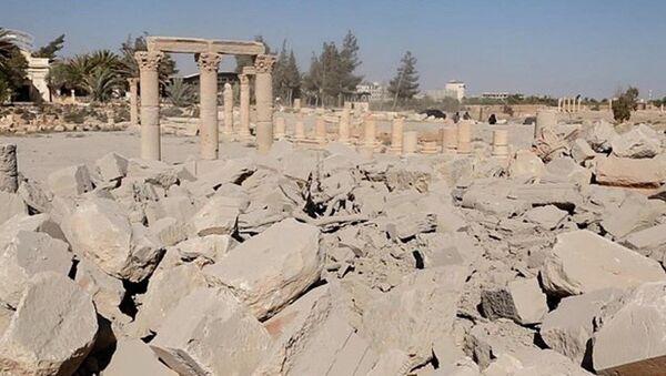 IŞİD, Palmira'daki tapınağın patlatılma fotoğraflarını yayınladı - Sputnik Türkiye