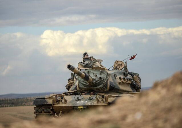 Turkish army tanks take position near the Syrian border (file photo)