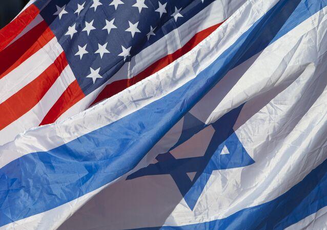 U.S. and Israeli flags fly as U.S. Secretary of State John Kerry arrives in Tel Aviv, Israel, Tuesday, Nov. 24, 2015
