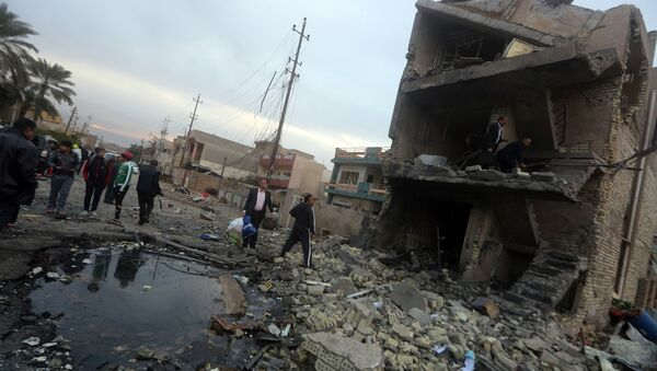 Bağdat'ta meydana gelen bir intihar saldırısı (12 Ocak 2016) - Sputnik Türkiye