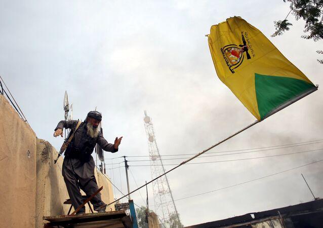 Peşmerhe güçleri, Tuzhurmatu'daki Şii milislere ait bayrağı indirdi