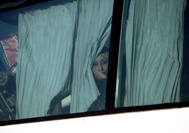 İdomeni'den tahliye edilen sığınmacılar