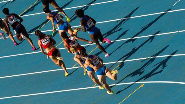 Dünya Atletizm Şampiyonası'nda koşan kadın atletler. - Sputnik Türkiye