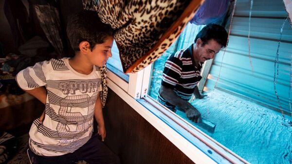 Za'atari kampında yaşayan Suriyeli raha ustası Abu Rabee - Sputnik Türkiye