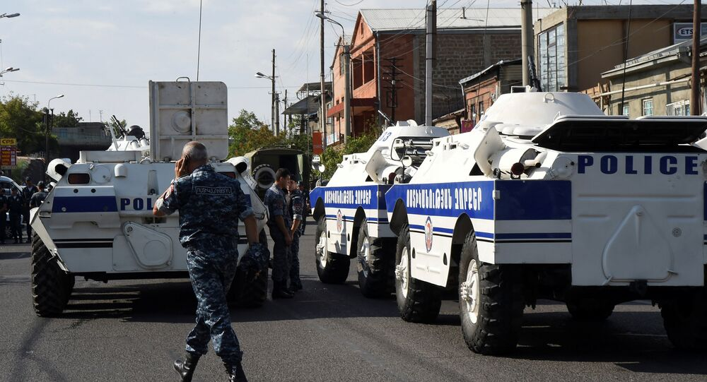 Policemen block a street after a group of armed men seized a police station along with an unknown number of hostages, according the country's security service, in Yerevan, Armenia, July 17, 2016.
