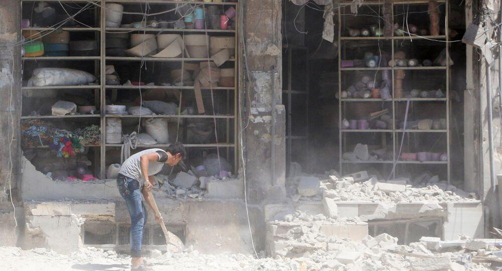 Suriye'nin Halep kentinin El Katerji mahallesine düzenlenen saldırının neden olduğu yıkım
