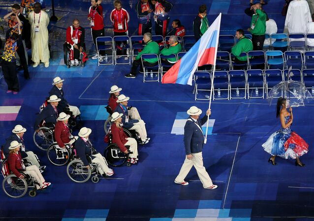 Standard-bearer of the Russian Paralympic team Alexei Ashapatov (right) at the opening ceremony of the XIV summer Paralympic Games at the Olympic Stadium in London