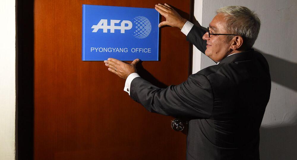 AFP CEO'su ve Yönetim Kurulu Başkanı Emmanuel Hoog, Pyonyang'taki büronun açılışında.