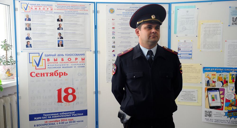 A police officer at a polling station during the preparation for the single election day on September 18