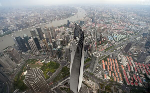 Shanghai'de bulunan yüksekliği 492 metre olan bir Çinli dev yani Dünya Finans Merkezi. Bu bina Çin'in en yüksek binası. Dünyada 5. sırada bulunuyor. - Sputnik Türkiye