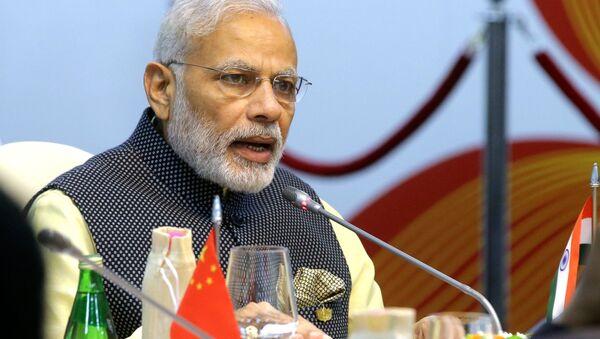 Indian Prime Minister Narendra Modi seen here at Taj Exotica Goa hotel, India at the BRICS Summit restricted meeting - Sputnik Türkiye