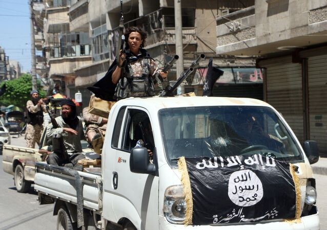 Fighters from Al-Qaeda's Syrian affiliate Al-Nusra Front drive in armed vehicles in the northern Syrian city of Aleppo as they head to a frontline. (File)