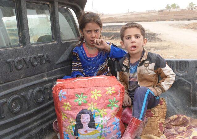 Musul'da evleri koasliyon uçakları tarafından bombalanan Esma ve Yusuf kardeşler