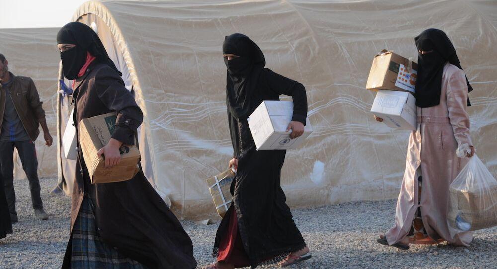 Musul'dan kaçan kadınlar