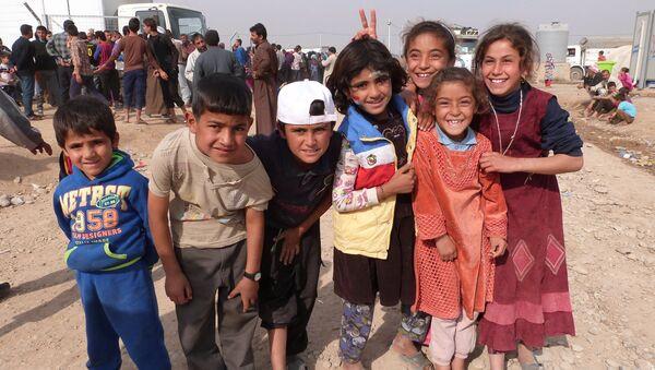 Musul'daki savaştan kaçan çocuklar - Sputnik Türkiye
