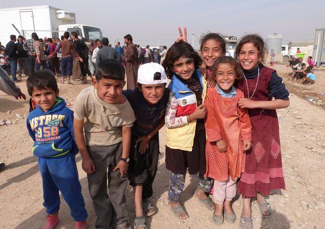 Musul'daki savaştan kaçan çocuklar
