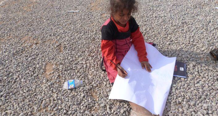 Musul'daki savaştan kaçan çocuklardan biri olan Büşra Yusuf