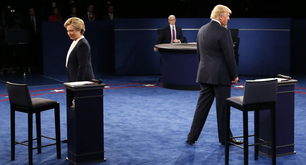 Democratic nominee Hillary Clinton (L) and Republican nominee Donald Trump arrive on stage during the second presidential debate at Washington University in St. Louis, Missouri on October 9, 2016