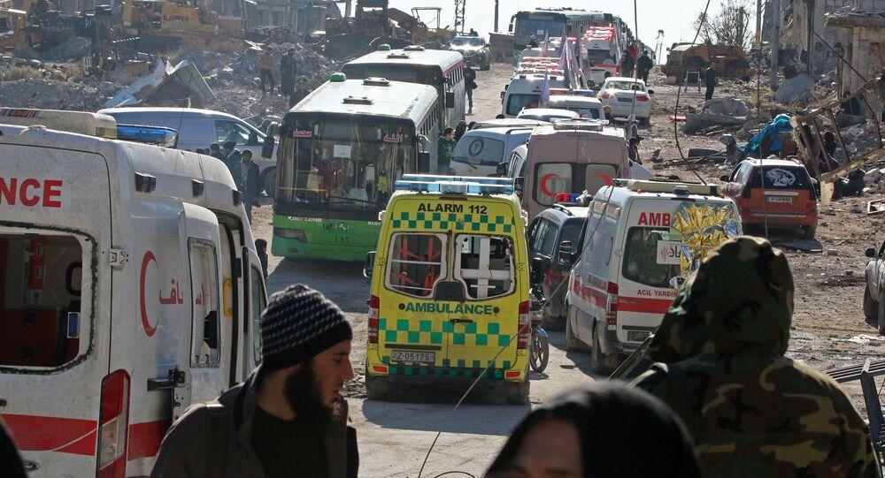 Militanlar ve aileleri Halep'ten tahliye ediliyor