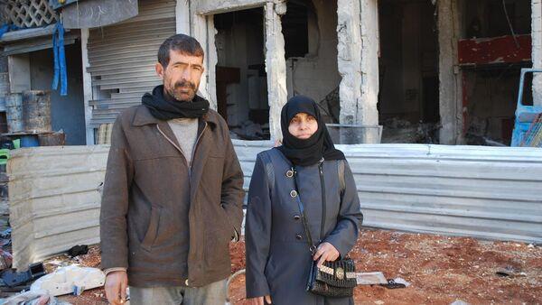 Halep'te radikal teröristlerin kendilerine yaptıklarını anlatan Suriyeli çift - Sputnik Türkiye