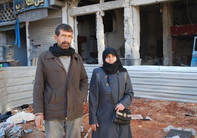 Halep'te radikal teröristlerin kendilerine yaptıklarını anlatan Suriyeli çift