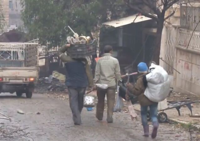 Doğu Halep sakinleri evlerine dönüyor