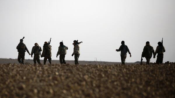 Suriye'de IŞİD ile savaşan YPG'nin başını çektiği DSG (Demokratik Suriye Güçleri) - Sputnik Türkiye