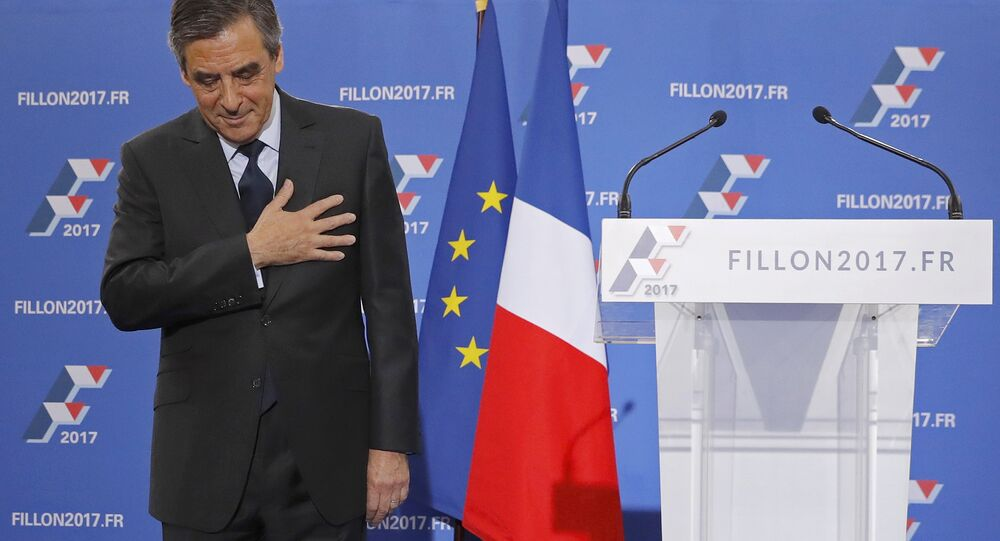 Francois Fillon, former French prime minister and member of Les Republicains political party, reacts as he delivers his speech after partial results in the second round for the French center-right presidential primary election in Paris, France, November 27, 2016.