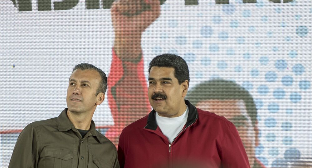 Tareck El Aissami ve Nicolas Maduro