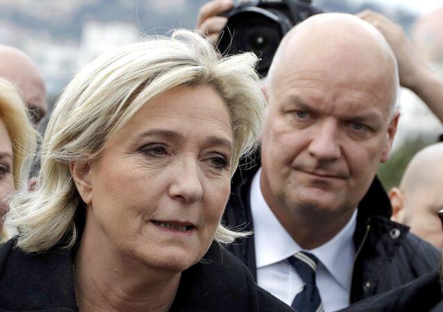 Marine Le Pen ve gözaltına alınan koruması Thierry Legier