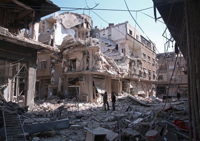 Kabun mahallesinde bombardıman sonucu yıkılan bir bina