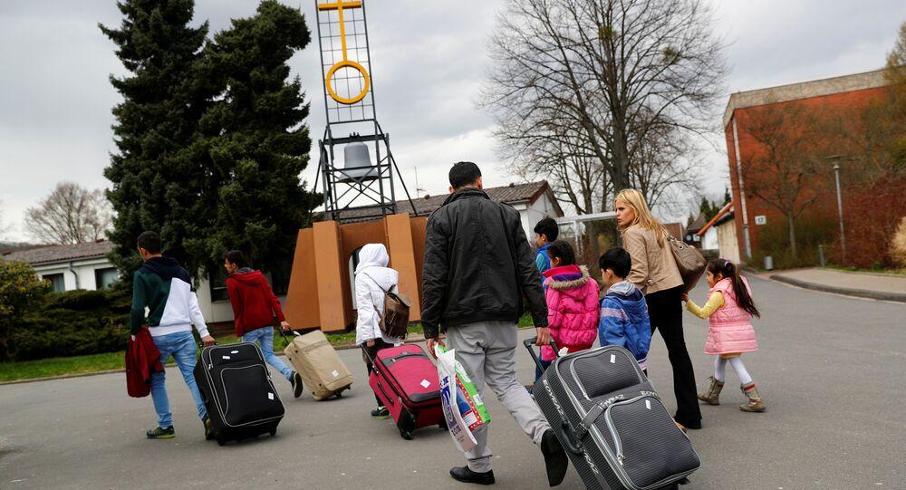 Almanya'da kampa yerleştirilen göçmenler
