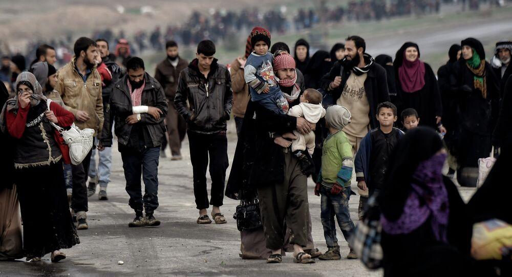 Irak'ın Musul kentinden kaçan siviller