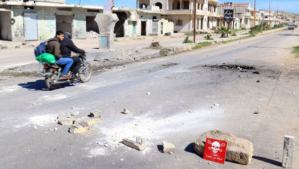 İdlib'in Han Şeyhun kasabaında kimyasal saldırı iddiası - Sputnik Türkiye