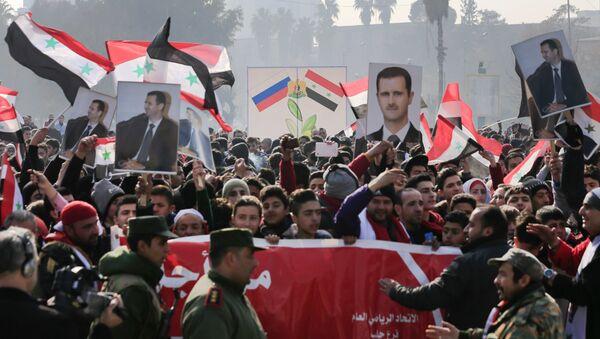 Suriye Devlet Başkanı Beşar Esad için Halep'te yapılan bir eylem - Sputnik Türkiye