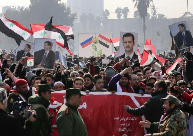 Suriye Devlet Başkanı Beşar Esad için Halep'te yapılan bir eylem
