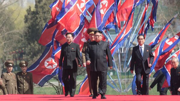 DPRK leader Kim Jong-il, center, at a ceremony to open a new residential area on Ryomyong Street in Pyongyang. - Sputnik Türkiye