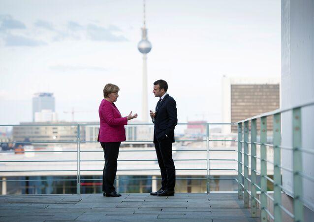 Almanya Başbakanı Angela Merkel ile Fransa Cumhurbaşkanı Emmanuel Macron Berlin'deki Başbakanlık binasında