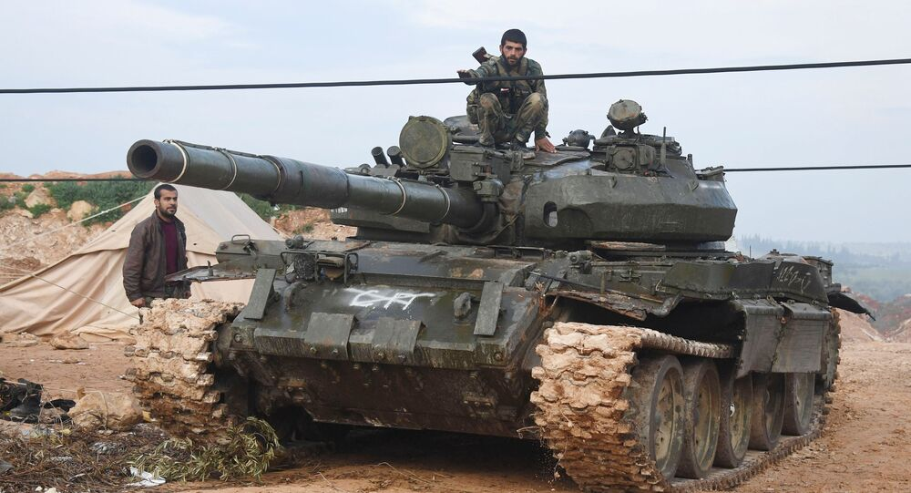 Syrian army troops during an assault on the city of Halfaya in the north of the Hama Governorate